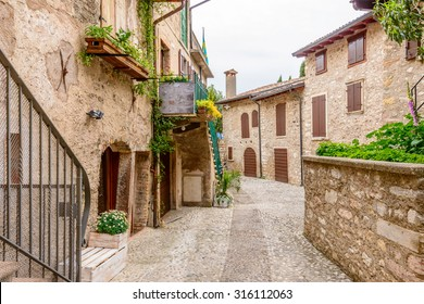 Picturesque small town street view in Limone, Lake Garda Italy.