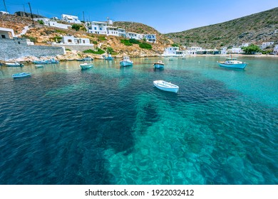 Picturesque small village of Heronissos, with fishing boats and transparent waters, in Sifnos island, Greece