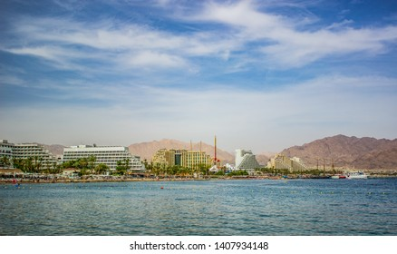 picturesque south Israeli city Eilat panorama vivid colorful summer scenery landscape with Gulf of Aqaba Red sea harbor and hotels shoreline, travel destination picture