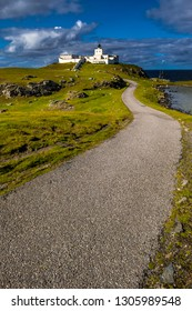 Picturesque Strathy Point Lighthouse Near Thurso At The Atlantic North Coast Of Scotland