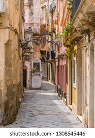 Picturesque street in Ortigia, Siracusa old town, Sicily, southern Italy. July-05-2018