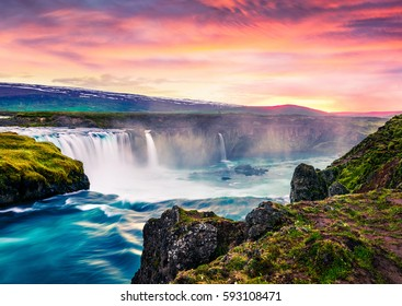 Picturesque summer morning scene on the Godafoss Waterfall. Colorful sunrise on the on Skjalfandafljot river, Iceland, Europe. Beauty of nature concept background.