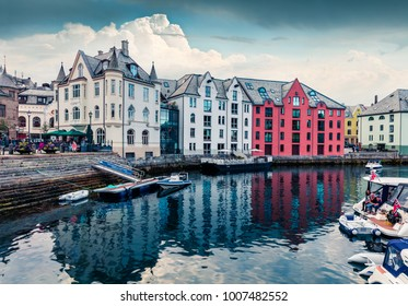 Picturesque summer view of Alesund port town on the west coast of Norway, at the entrance to the Geirangerfjord. Colorful morning cityscape. Traveling concept background.