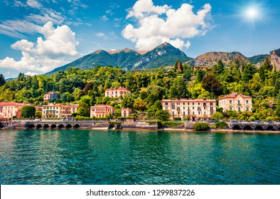 Picturesque summer view from ferry boat of Cadenabbia town. Bright morning scene of Como lake, Italy, Europe. Traveling concept background.