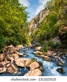 Picturesque summerview of Cheile Turzii / Turzii's Gorge canyon, large natural preserve with marked trails for scenic gorge hikes crossing streams & bridges. Beauty of nature concept background.