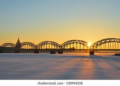 Picturesque sunrise over the Railway Bridge in Riga, Latvia