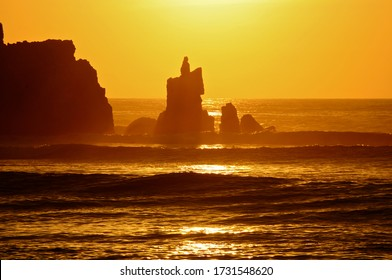 Picturesque sunset against the rocks of Cerro Azul beach in Lima-PERU