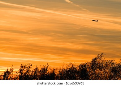 Picturesque sunset and air plain in the sky