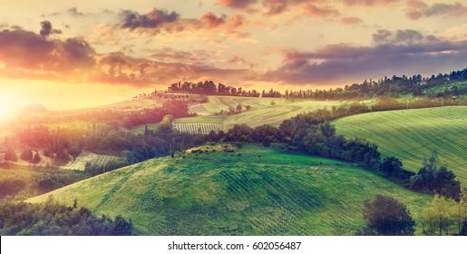 Picturesque sunset over green hills sunshine Italy dramatic sky cloud panorama landscape. Bologna. Tuscany