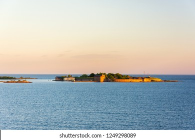 Picturesque sunset view on the island with Kungsholms Fort (coastal artillery fortress for control of Karlskrona harbour). Location place: the Baltic Sea near Karlskrona, Sweden.
