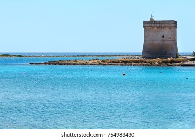 Picturesque Torre Chianca beach and historical fortification tower Torre Chianca (Torre Santo Stefano) on Salento Ionian sea coast, Porto Cesareo, Puglia, Italy