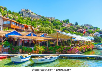 Picturesque tourist village of Kalekoy located on site of ancient Simena settlement, it boasts preserved castle ruins, numerous coastal cafes and bars, nice beaches and idyllic nature, Kekova, Turkey.