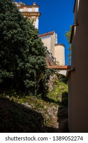 Picturesque town of Mikulov in spring sunny day with blossoming bushes and trees. Mikulov, spread out on the hills of Pálava and surrounded by vineyards and wine, can be found here every step of way