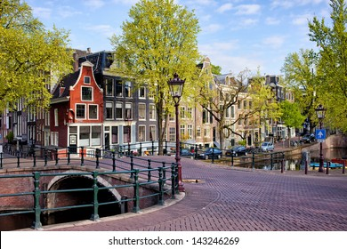 Picturesque traditional Dutch houses and bridge on the Reguliersgracht canal in Amsterdam, Holland, Netherlands.
