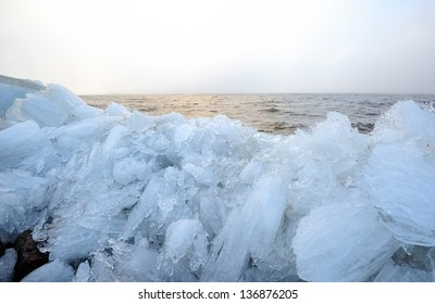 Picturesque twilight landscape of the Baltic sea with rubble ice in the foreground