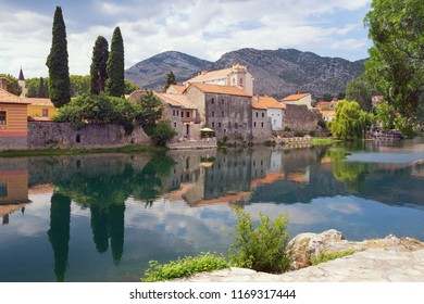 Picturesque view of ancient city on river bank.  Bosnia and Herzegovina,  Trebisnjica river and Old Town of Trebinje