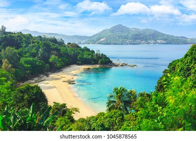 Picturesque view of Andaman sea in Phuket island, Thailand. View through the jungle on the beautiful bay and mountains. Tropical beach Laem Singh.