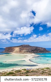 Picturesque view of Balos bay on Crete island, Greece. Tourists relax and bath in crystal clear azure water of Balos beach.