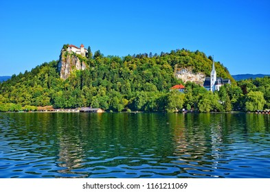 Picturesque view of the Bled Castle surrounded by the Lake Bled, Slovenia. It is the oldest Slovenian castle and currently one of the most visited tourist attractions in Slovenia.