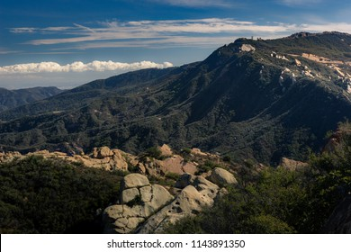Picturesque view of Calabasas Peak State Park on a sunny day with blue sky and clouds, Calabasas, California
