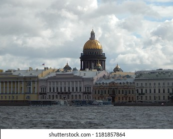 A picturesque view of the English embankment and the dome of St. Isaac's Cathedral across the Neva River
