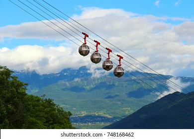 Picturesque view of French Alps and Grenoble-Bastille cable car in summer, France