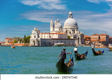 Picturesque view of Gondolas on Canal Grande with Basilica di Santa Maria della Salute in the background, Venice, Italy