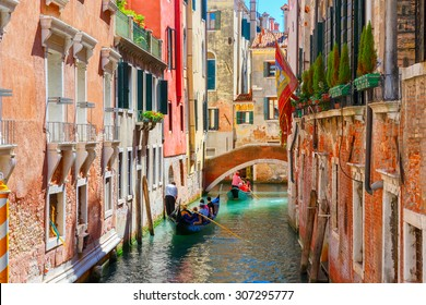 Picturesque view of Gondolas on lateral narrow Canal, Venice, Italy.