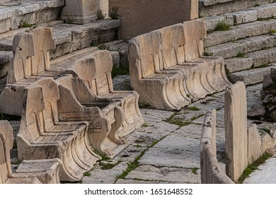 Picturesque view of Greek ruins of Theatre of Dionysos Eleuthereus - stone Roman Theater at the Acropolis hill. Theater dedicated to Dionysus, the god of plays and wine. Athens, Greece.