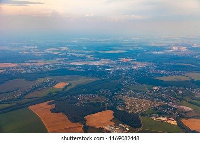 Picturesque view of the land surface from a window of the plane flying at big height