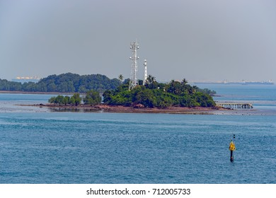 Picturesque view of Lighthouse in Strait of Singapore during low tide.