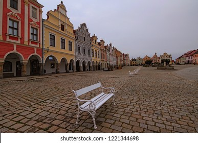 Picturesque view of medieval square in Telc. Fountain with statue of st. Margaret, Plague Column. Authentic colorful houses around the square. A UNESCO world heritage site. Telc, Czech Republic.