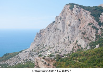 Picturesque view of mountainous Crimea and Voskresenskaya church build on Red Rock cliff, Russia