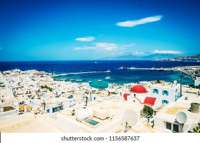 Picturesque view of Mykonos town and churh with red dome at sunny day