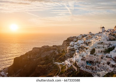 Picturesque view of Oia village on the Santorini island at sunset, Greece