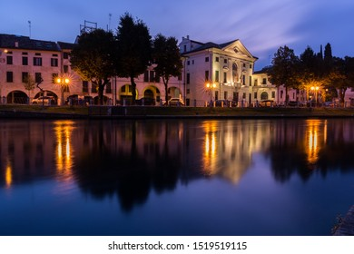Picturesque view on the Sile river in the city center with lights reflections on the water at night Treviso Italy