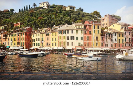 Picturesque view of Portofino waterfront with the brightly colored buildings, coffee shops and restaurants line