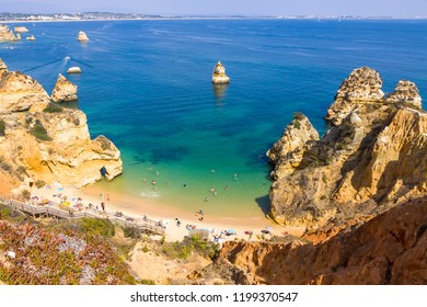 Picturesque view of Praia do Camilo beach in Lagos, Algarve region, Portugal. Praia do Camilo is one of the best beaches in Algarve. Famous for the crystal clear water and impressive cliff formations