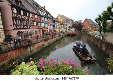 "Picturesque view of the river and the old half-timbered houses located in  Colmar city, Rutenau disctrict, France, and called ""la petite venise"". August, 7, 2019. Row of colored facades with wood."