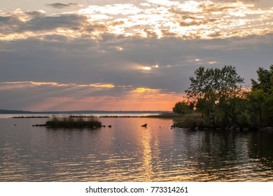 Picturesque view of the river at sunset with cloudy sky in spring evening