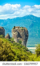 Picturesque view of rock formation Meteora in central Greece. Holy Trinity Monastery (Agia Triada).