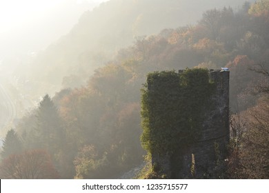 Picturesque view of a ruined watchtower emerging from the morning fog near the river Rhine,  outside the town of Bacharach (Rhineland-Palatinate).