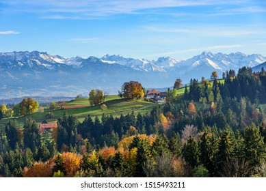 Picturesque view to the snow-covered Allgäu mountains on a sunny afternoon in october