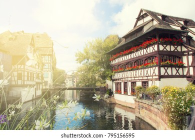 Picturesque view of traditional Alsatian half-timbered houses in Petite France. Strasbourg, Alsace, France. Romantic golden light