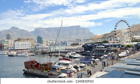 Picturesque view of the waterfront harbour in Cape Town at the Victoria and Alfred waterfront. Busy fishing port. Cape Town city, South Africa, Africa. December 2018