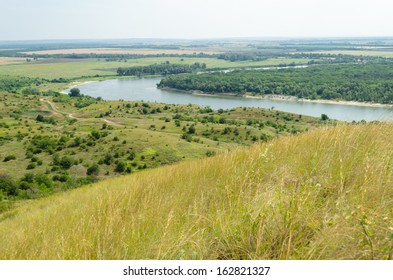 A picturesque view of the wide river, fields and meadows - Shutterstock ID 162821327