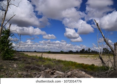 Picturesque views during spring season, beautiful landscape of a dry riverbed with cumulus clouds above. Areas of Kern river, that are visible from the Kern River Parkway, Bakersfield, California.