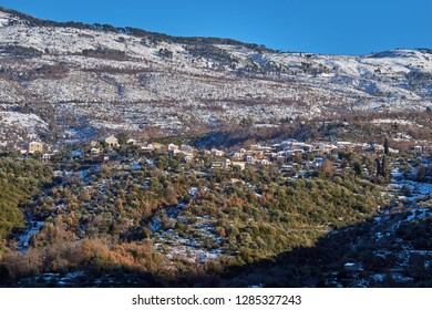 The picturesque village of Artemisia on the snowy Taigetus mountain (also known as Taugetus or Taygetos). Artemisia is a small cozy village about half an hour from Kalamata city in Peloponnese Greece