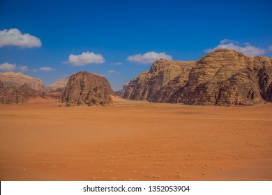 picturesque vivid yellow and orange colorful sunny Utah desert scenery landscape with mountain ridge background
