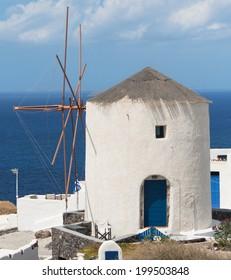 Picturesque windmill in Oia, Santorini Island, Greece.